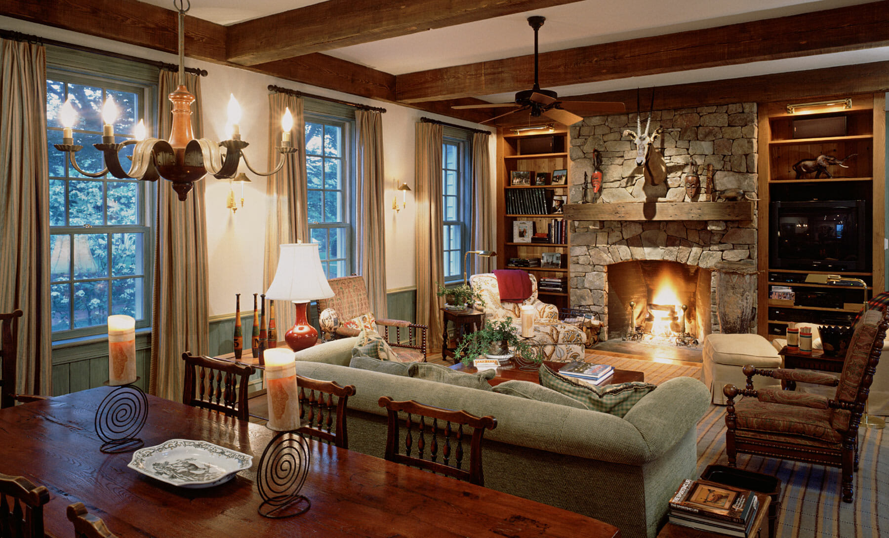 Open layout living room with stone fireplace, located in Charlottesville VA, constructed by GME Builders