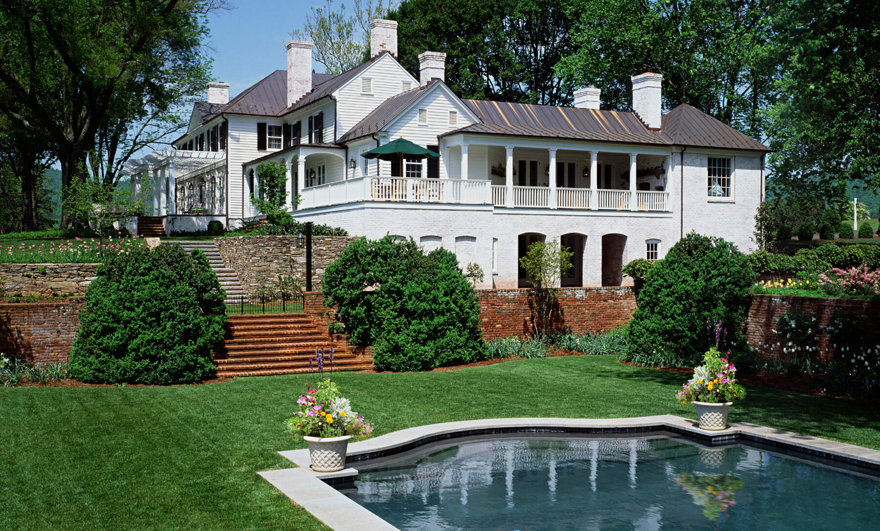 GME Builders specializes in high-end residential construction in Charlottesville and Albemarle, such as this new home with a terraced garden and swimming pool