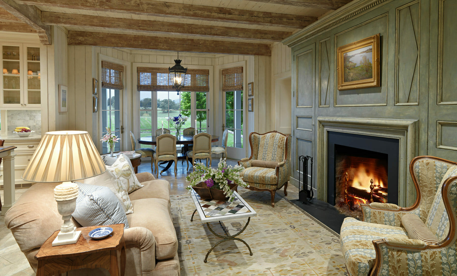 Living room with fireplace and exposed wooden beams built by GME builders in Charlottesville, Virginia.