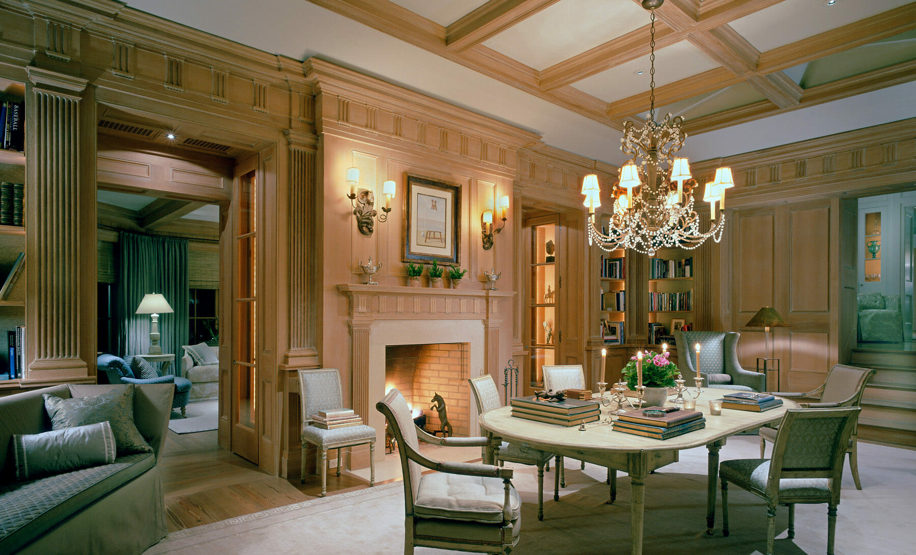 Charlottesville Open-layout study with a fireplace and chandelier, construction done by GME Builders